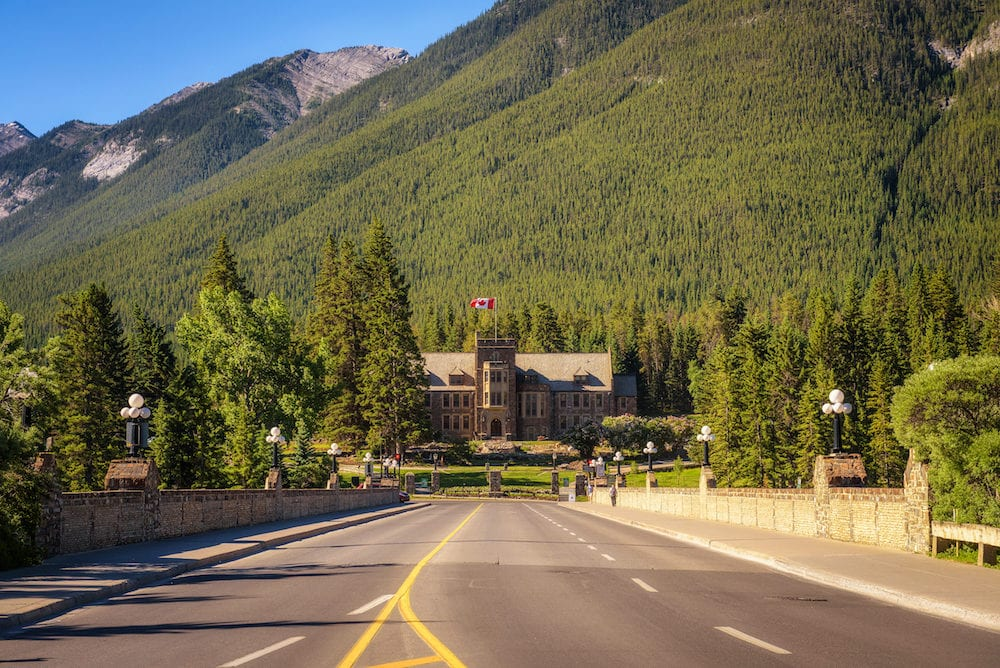 BANFF, ALBERTA, CANADA : Scenic street view of the Banff Avenue and Parks Canada Administration Building in Cascade Gardens. Banff is a resort town and popular tourist destination.