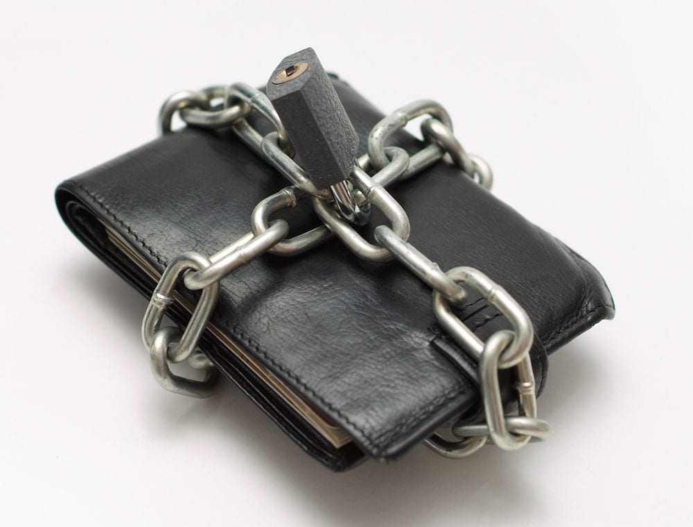 Locked wallet with chain and padlock save money concept