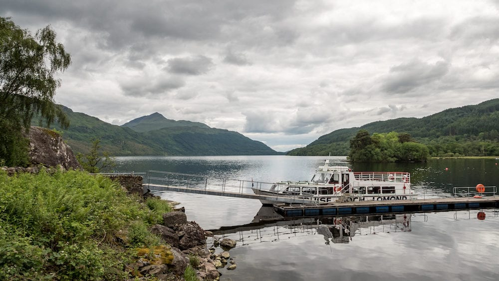 LOCH LOMOND, SCOTLAND - A tourist cruise ship on the banks of Loch Lomond in the heart of The Trossachs in the Scottish Highlands.