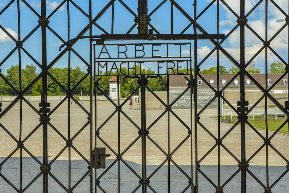 Dachau Concentration Camp Germany - Arbeit Macht Frei the gate of entrance in extermination camp. Dachau concentration camp was the first of the Nazi concentration camps opened in Germany intended to hold political prisoners.