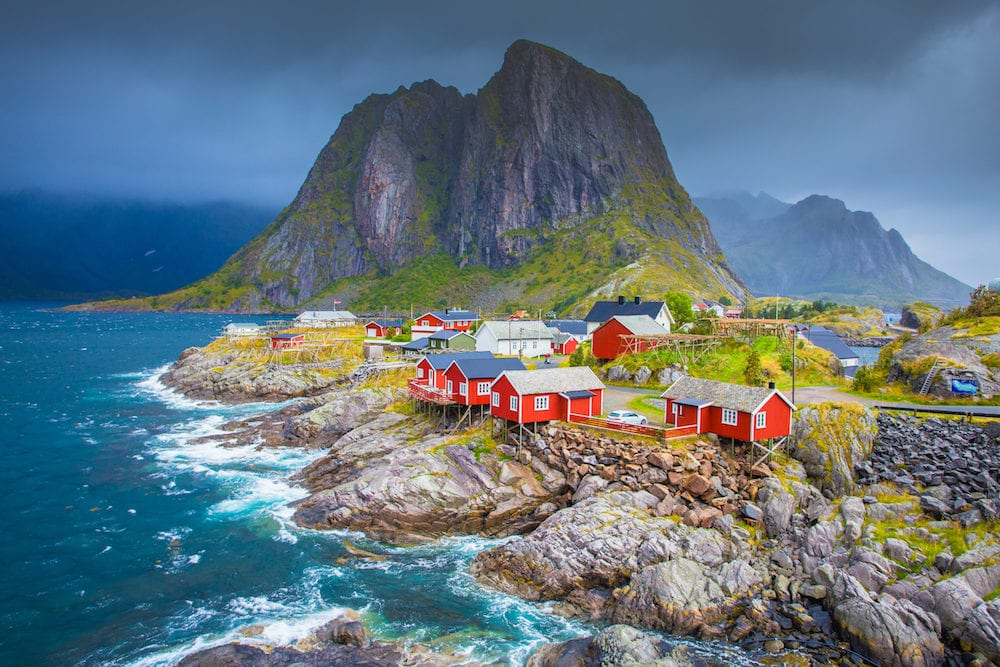 Norway, Lofoten islands. Spring day in Norway. Beautiful seascape of Lofoten islands. Red fishing houses on stone seaside.