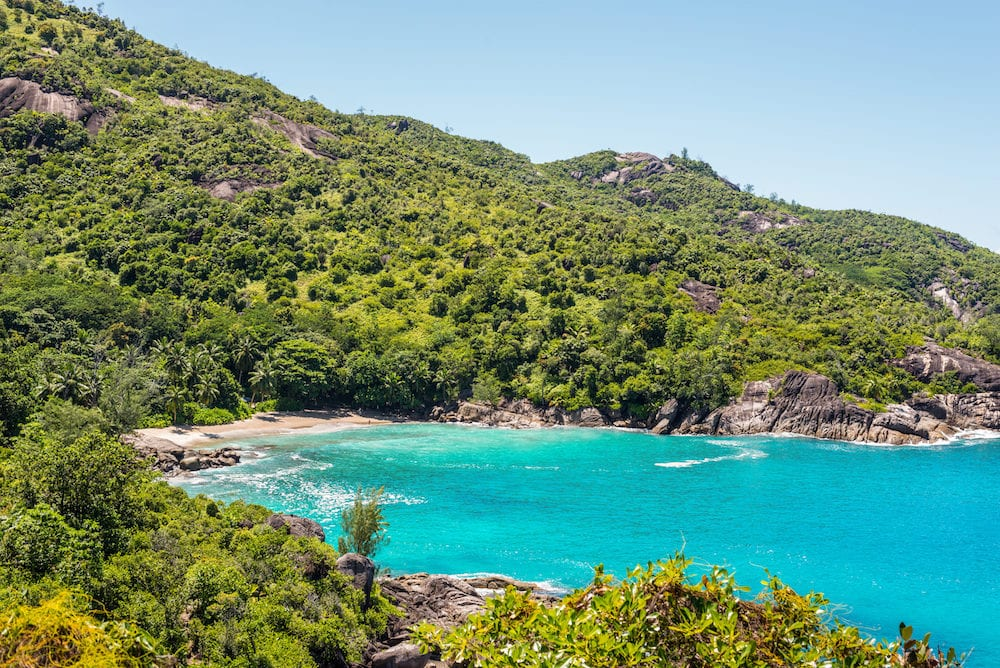 Anse Major beach - one of the many scenic beaches decorated with granitic boulders on the Mahe island Seychelles can be reached by one hour long trek through beautiful nature - Anse Major Nature Trail Mahe Island Seychelles Indian Ocean Eastern Africa