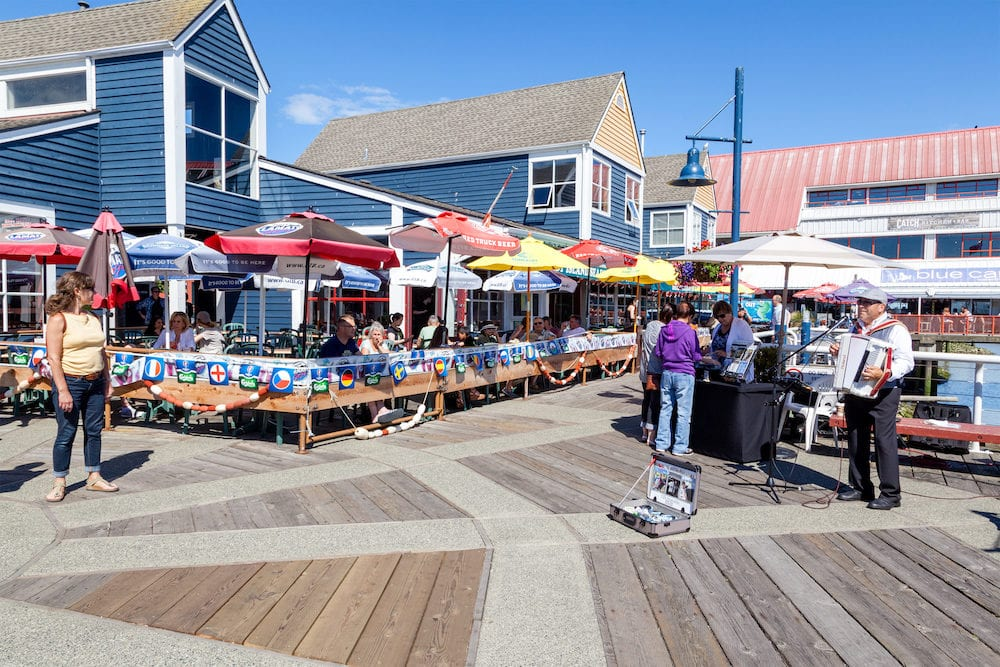 RICHMOND, CANADA - Visitors at the picturesque seaside village of Steveston in Richmond near Vancouver. The popular Fisherman's Wharf is famous for fresh seafood, the many eateries and unique shops.