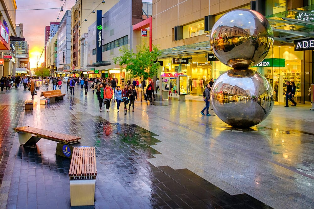 Adelaide Australia - People walking along the Rundle Mall in Adelaide CBD at sunset viewing towards West. Rundle Mall is the premier shopping area of South Australia
