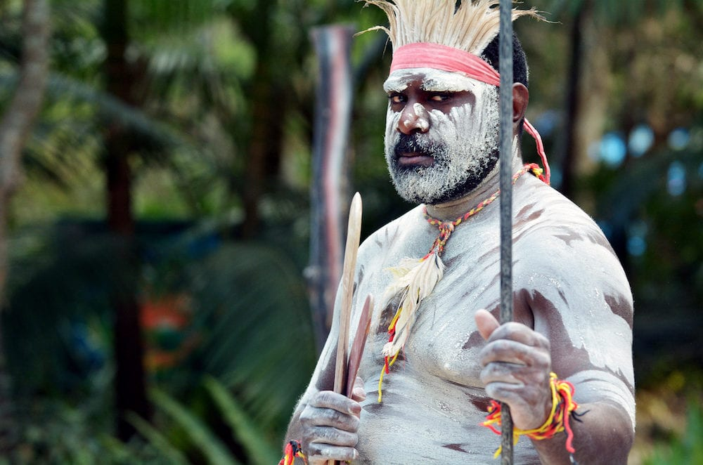 Portrait of one Yugambeh Aboriginal warrior man preform Aboriginal culture martial art during cultural show in Queensland Australia.