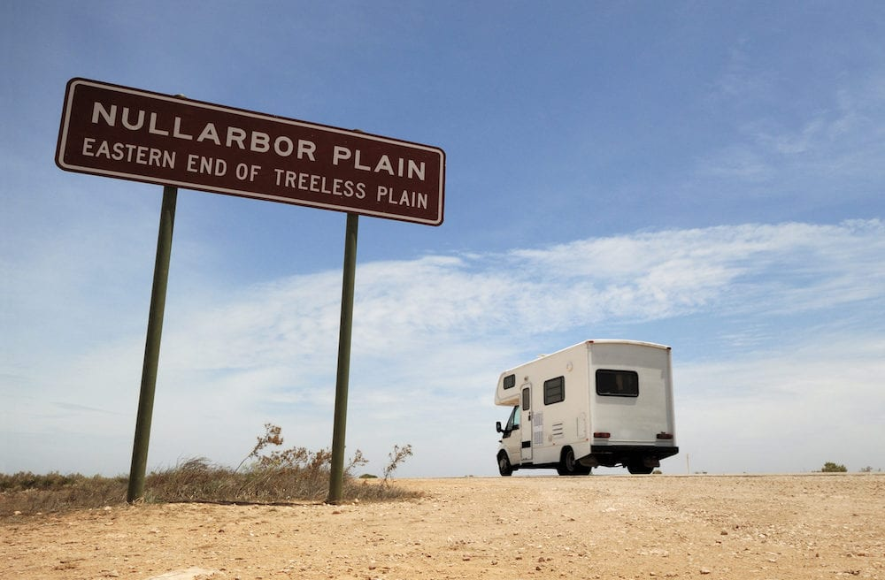 An Australian Outback touring camper on the road in the Nullarbor Plain.