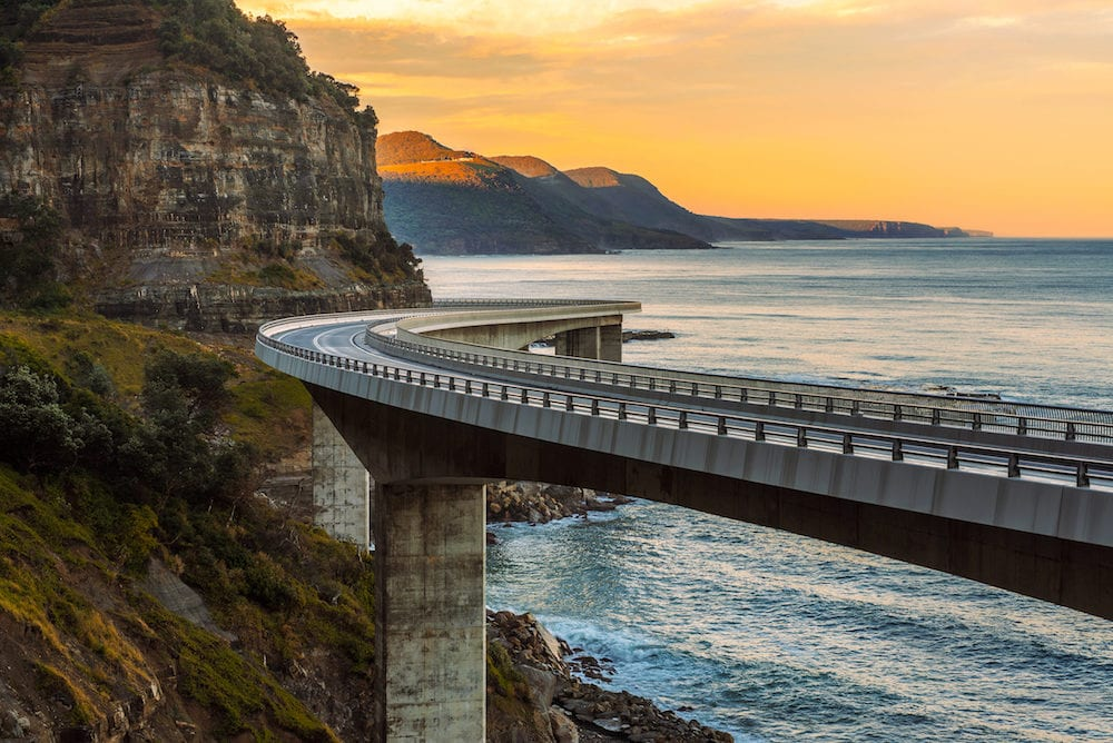 Sunset over the Sea cliff bridge along Australian Pacific ocean coast near Sydney, Australia.