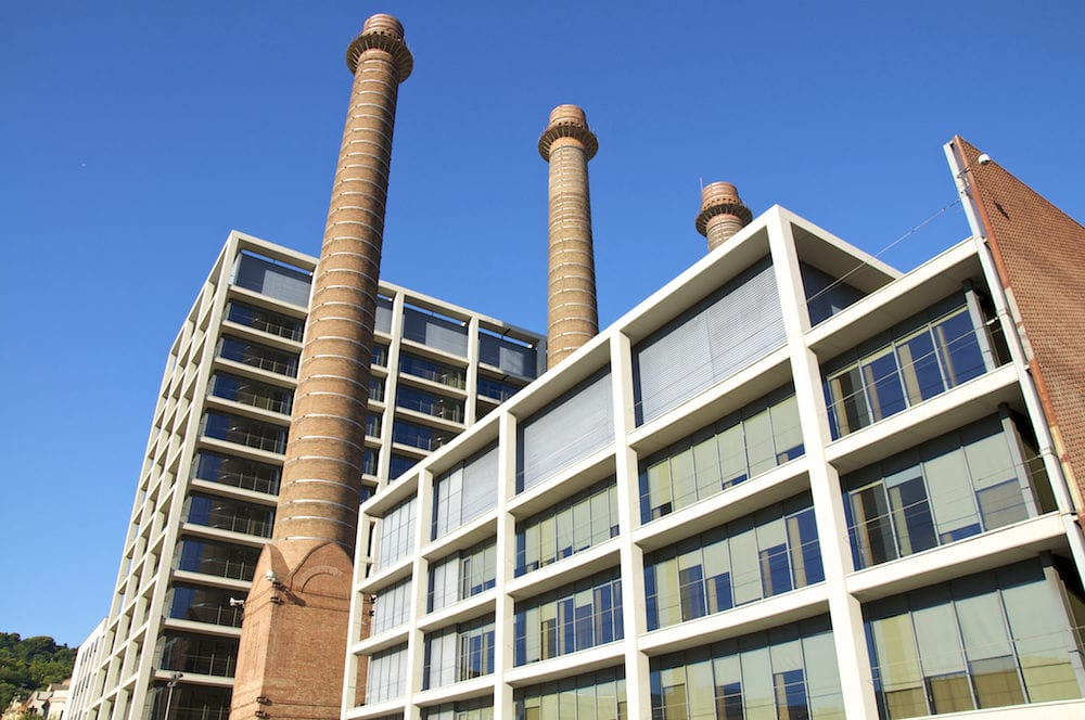 Chimneys at the Office building of the former power station in Barcelona's District Poble Sec