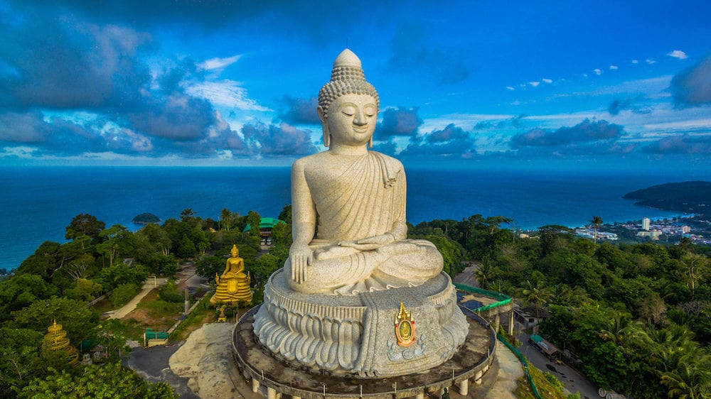 aerial photography white great Phukets big Buddha in blue sky. Phuket's Big Buddha is one of the island's most important and revered landmarks on the island.