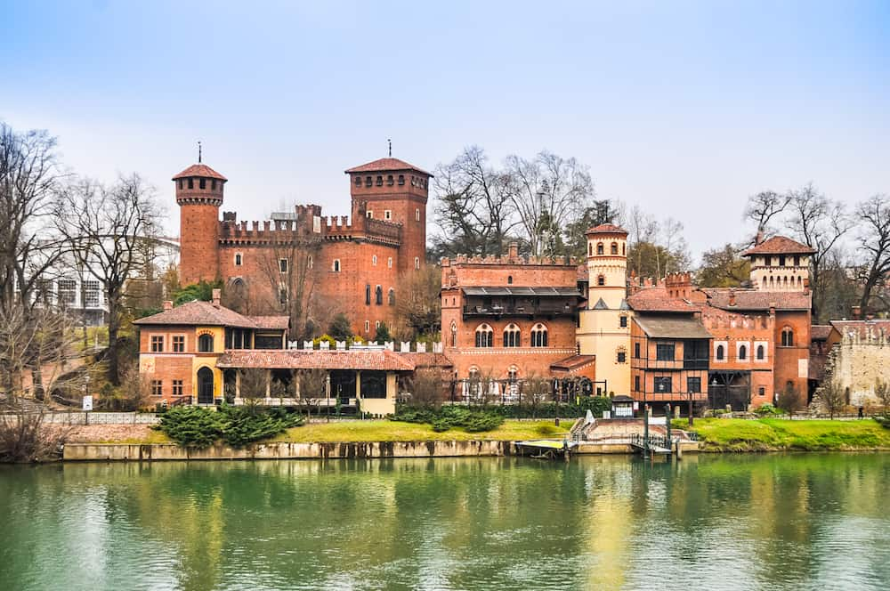 Castello Medievale (meaning Medieval Castle) in Parco del Valentino seen from river Po bankside in Turin Italy