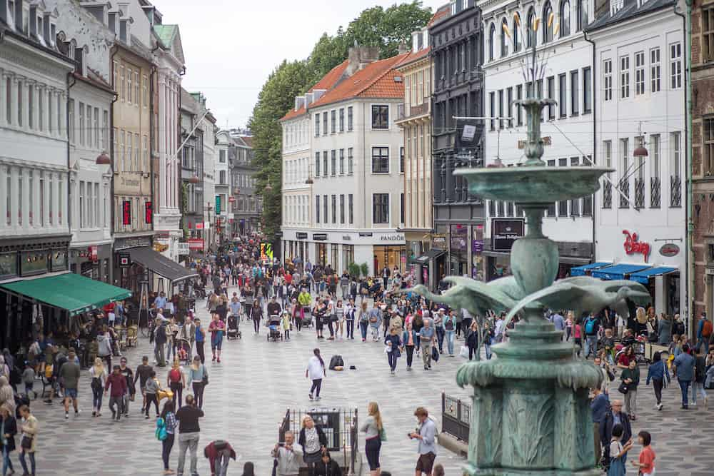 Copenhagen, Denmark - People on main pedestrian and shopping street called Stroget in historic city centre