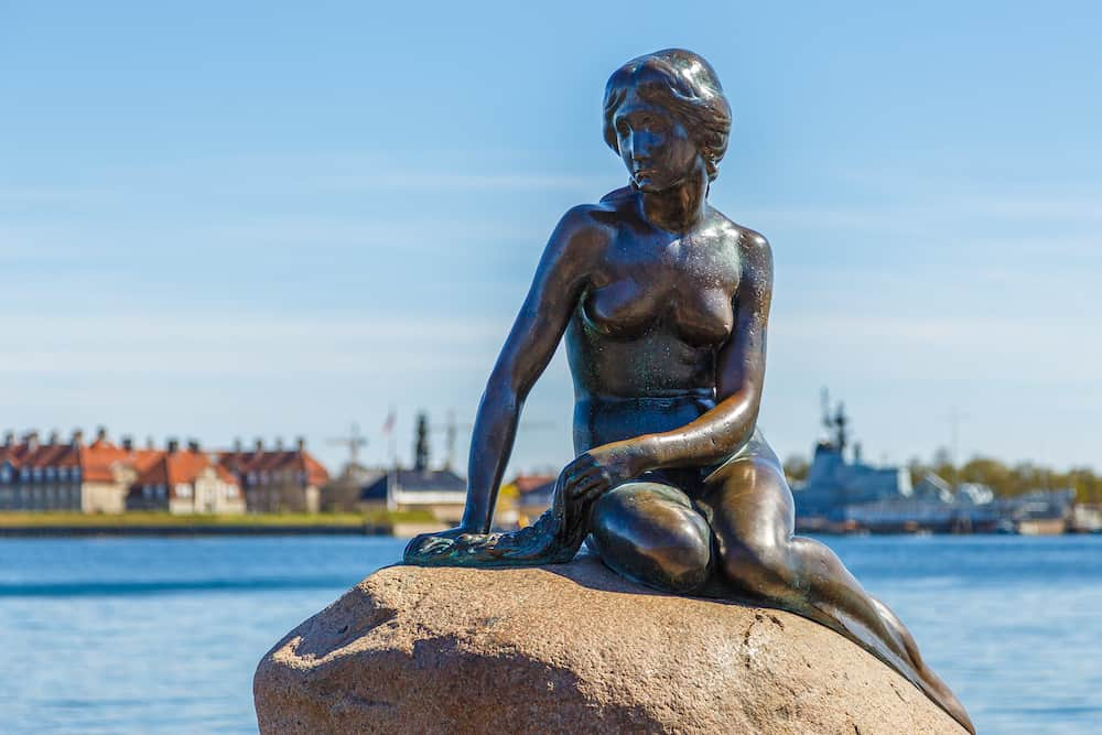 Copenhagen, Denmark- The Little Mermaid bronze statue depicting a mermaid. The sculpture is displayed on a rock by the waterside at the Langelinie promenade in Copenhagen.