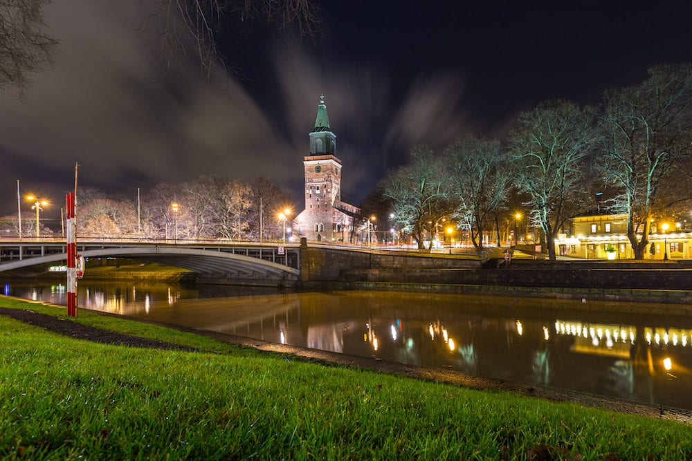 TURKU, FINLAND- : View of the Turku Cathedral and Aura river by night. Turku Cathedral is the Mother Church of the Evangelical Lutheran Church of Finland.