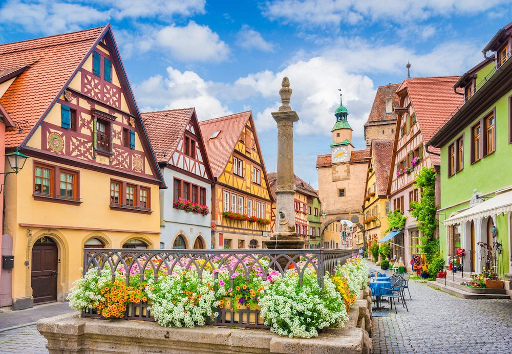 Beautiful postcard view of the famous historic town of Rothenburg ob der Tauber on a sunny day with blue sky and clouds in summer Franconia Bavaria Germany