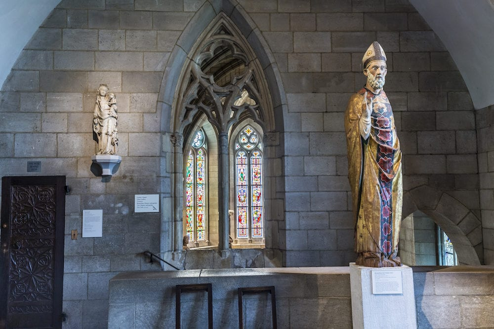 NEW YORK USA -: religious statue at the Sanctuary at the Cloisters museum in New York USA. The cloisters was built by original european artefacts by Rockefeller.