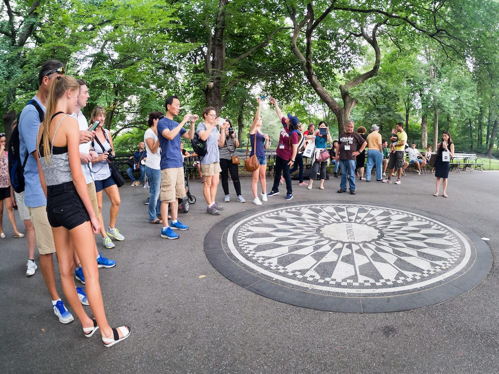 NEW YORK,USA - Tourists at the Imagine mosaic commemorating John Lennon at Strawberry Fields in Central Park