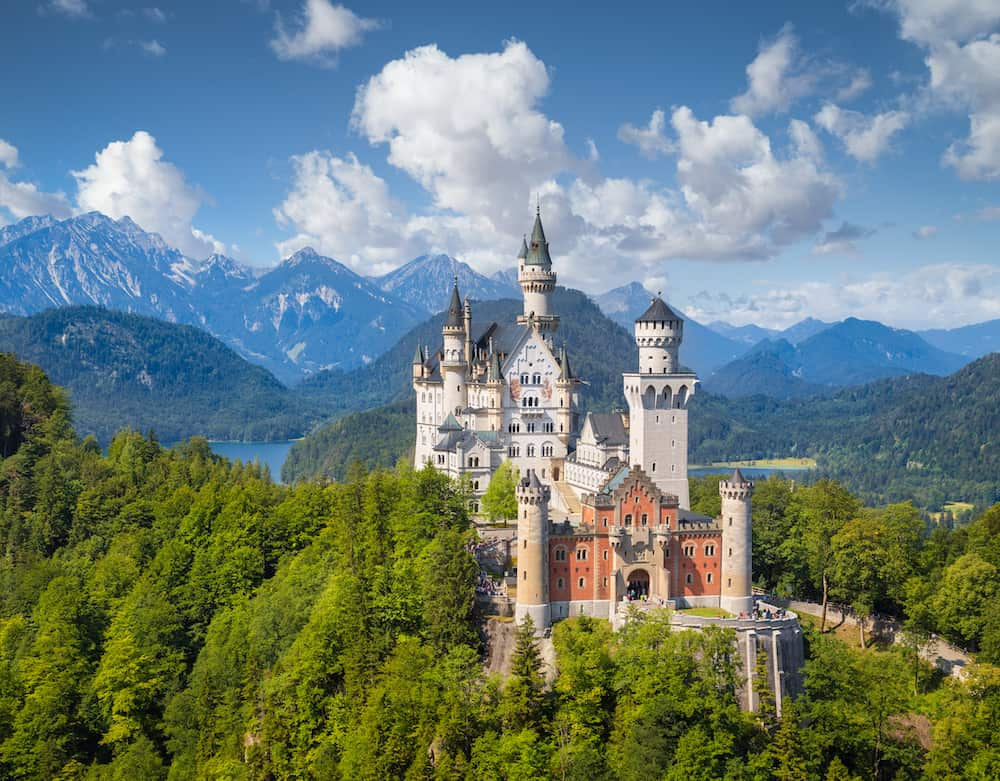 Beautiful view of world-famous Neuschwanstein Castle the romantic 19th century Romanesque Revival palace built for King Ludwig II with scenic mountain landscape in Fussen southwest Bavaria Germany