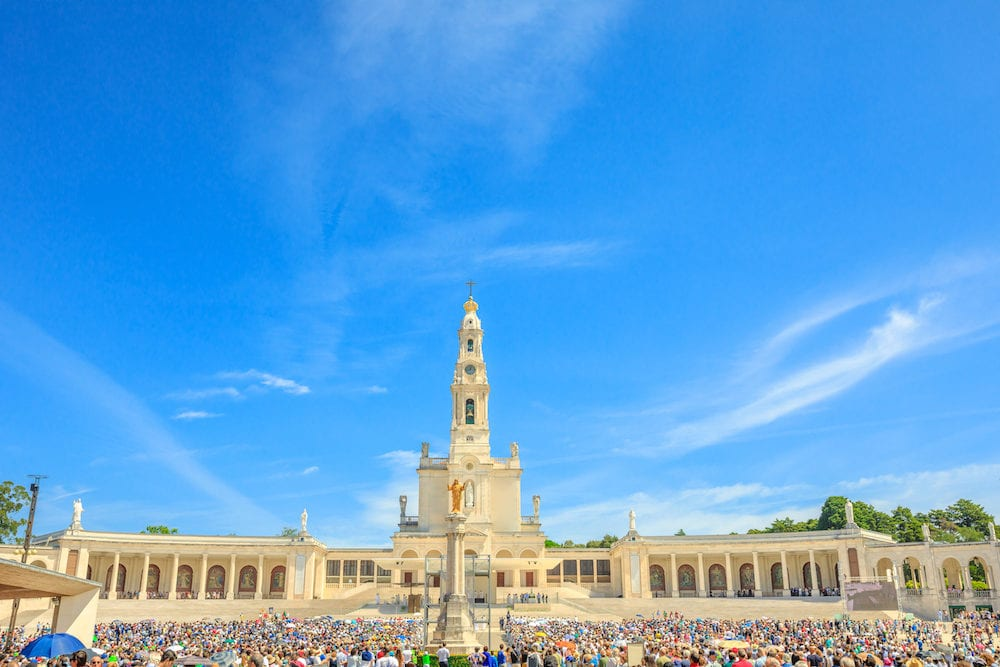 Tourists, faithful and pilgrims in the square of the Sanctuary of Fatima in Portugal for the 100th anniversary of the apparitions of the Virgin Mary.