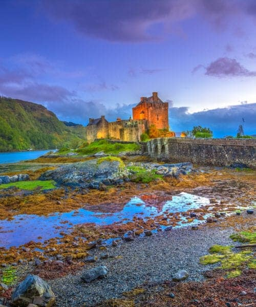 Blue hour twilight at Eilean Donan Castle, Dornie town, in Scotland, United Kingdom. A 13th Century Castle in the Highlands of Scotland.Eilean Donan Castle is the most visited castle in the UK.