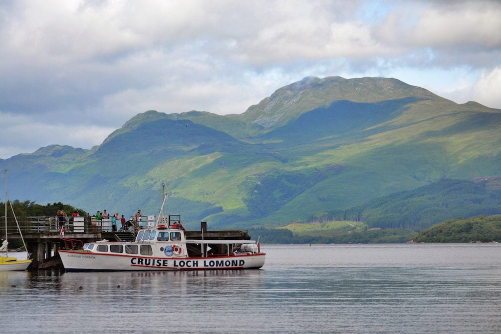 LUSS, UNITED KINGDOM - : Boat cruise on Loch Lomond - the largest inland stretch of water in Great Britain in Luss, Scotland, UK.