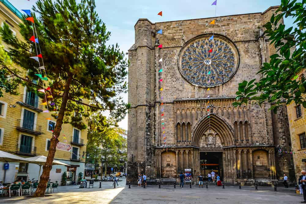Barcelona, Spain - 14th-century Gothic church Santa Maria del Pi in the gothic quarter of Barcelona Spain in Placa del Pi with colorful flags and a small cafe