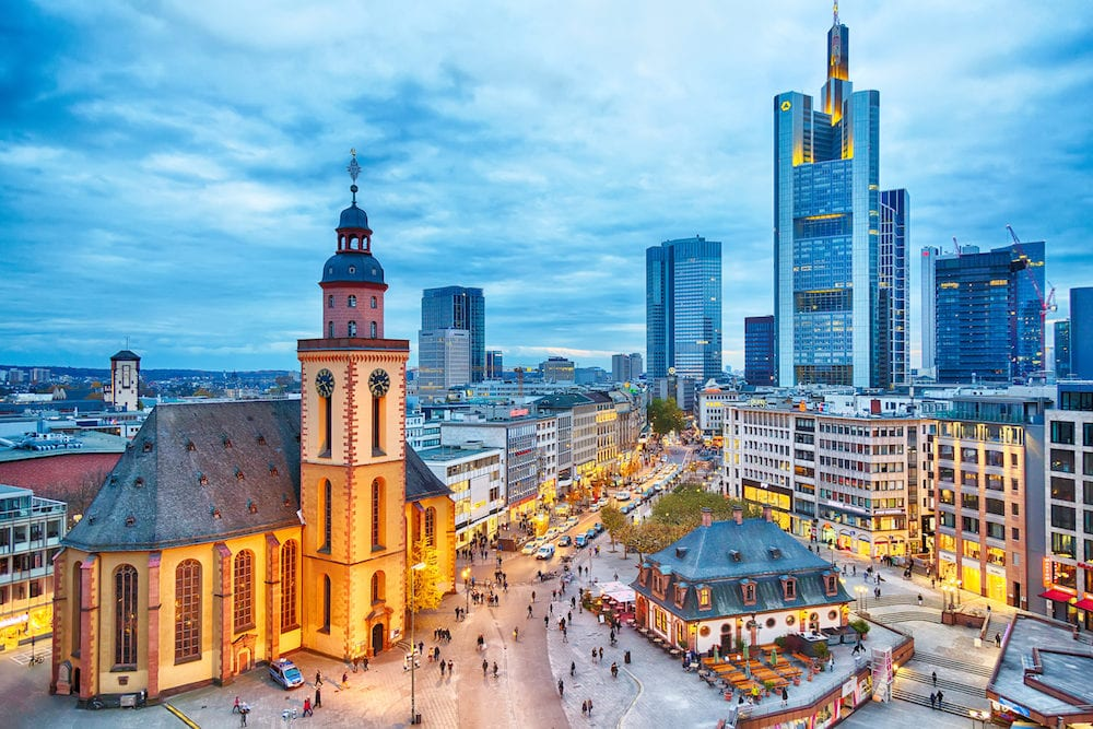 FRANKFURT GERMANY - View to skyline of Frankfurt in sunset blue hour. St Paul's Church and the Hauptwache Main Guard building at Frankfurt central street Zeil