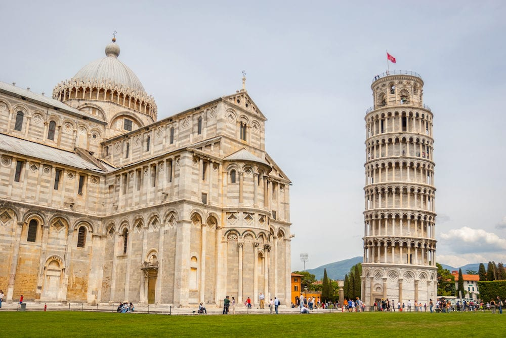 PISA, ITALY - Tourist sightseeing Pisa Cathedral, Roman Catholic cathedral dedicated to the Assumption of the Mary and the Leaning Tower of Pisa, bell tower of cathedral in Pisa, Italy.