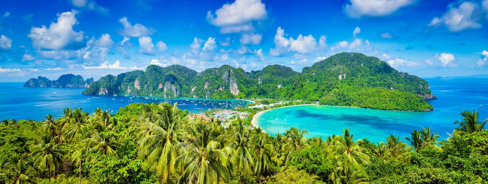 Thailand tropical vacation holidays concept background - panorama of tropical islands Phi Phi Don and Phi Phi Leh in sea. Crabi, Thailand