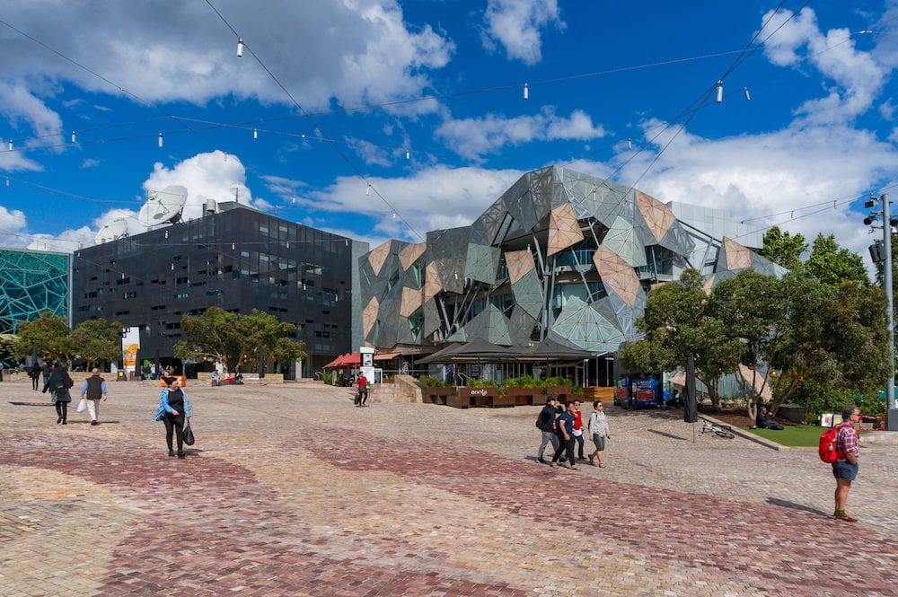 Melbourne, Australia - Melbourne city centre Federation Square with people on sunny day