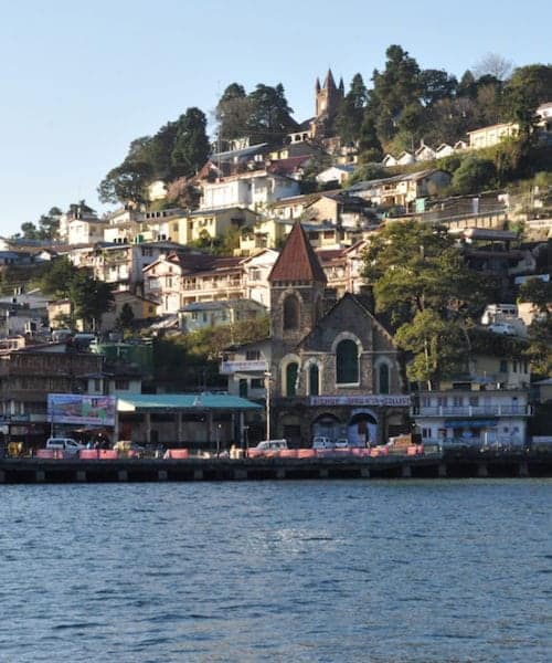 Beauty of Naini Lake and Bus stand area early in the morning view form Mall Road, Nainital, Uttarakhand, India. Nainital is a popular hill station in Uttarakhand, named after the Goddess Naina Devi. It also known as the 'Gateway to Kuma