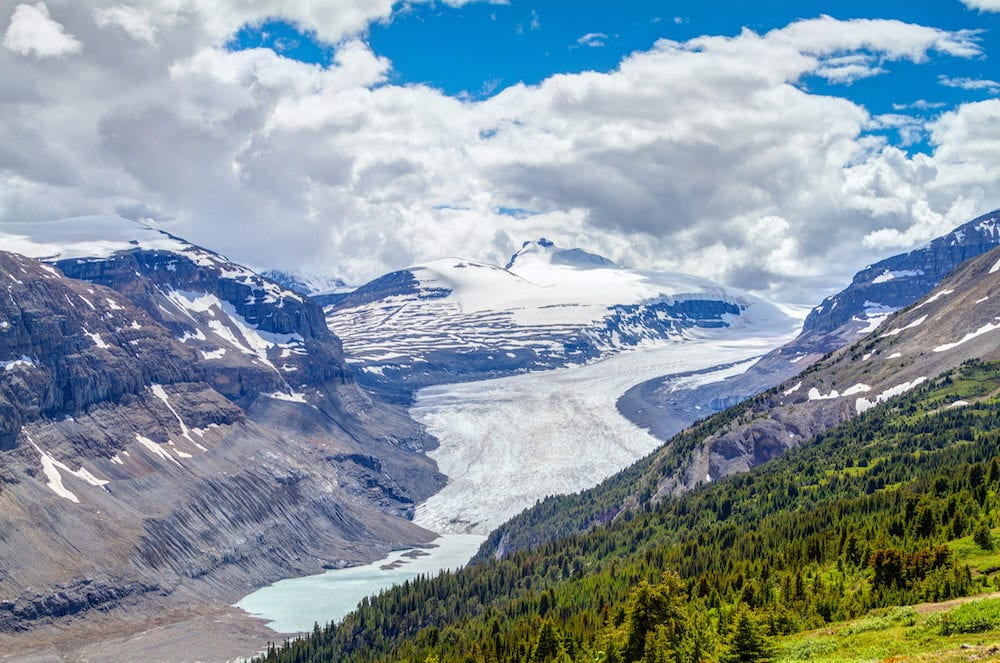Sweeping vista of Saskatchewan Glacier flowing from the Columbia Icefields as seen from the crest of Parker Ridge on the Icefields Parkway in Jasper National Park in the Canadian Rockies. Mount Athabasca can be seen in the background.
