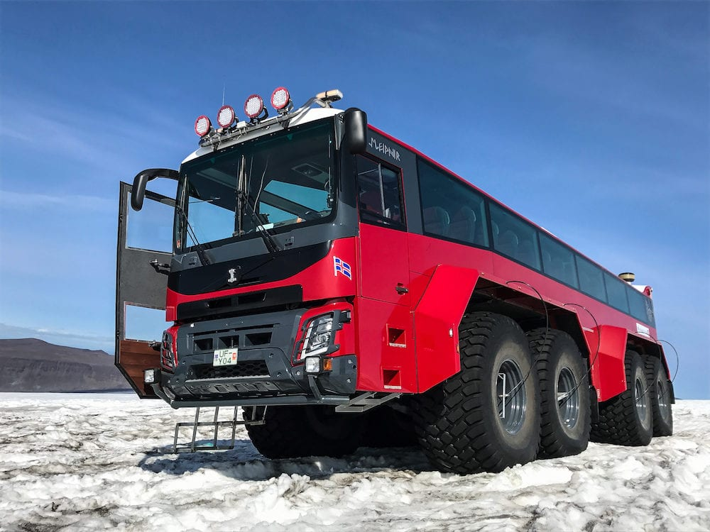 "Husafell Iceland Red specialty vehicle for driving on the snow stands on the surface of Langjokull glacier. This is a part of ""Into the Glacier"" operation."