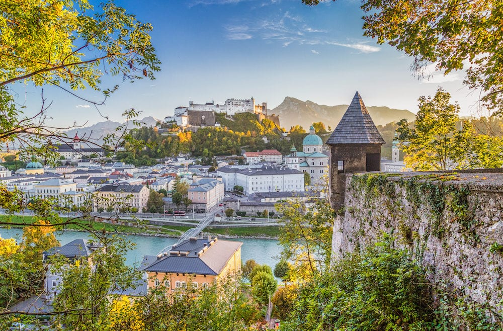 Aerial panoramic view of the historic city of Salzburg with famous Hohensalzburg Fortress and fortification tower in beautiful golden evening light at sunset in fall Salzburger Land Austria