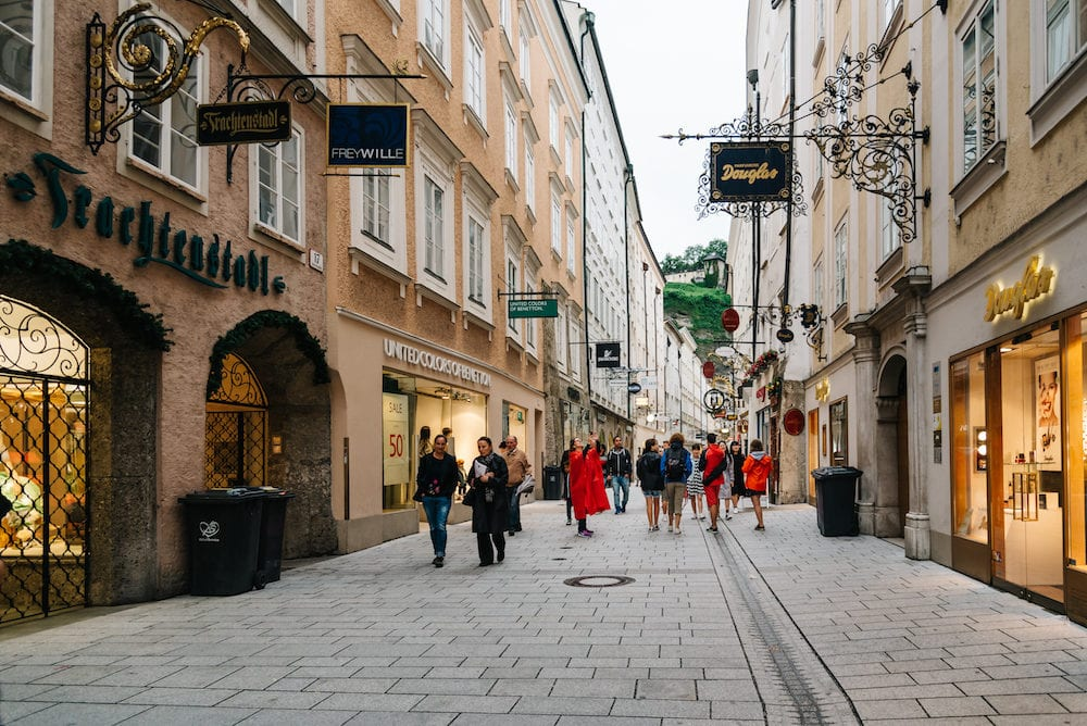 Salzburg, Austria -Getreidegasse. Scenic cityscape of historical city centre of Salzburg with a crowd of people walking