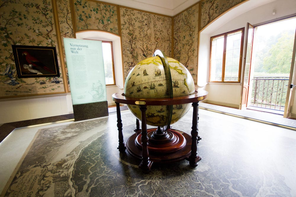 Salzburg Austria Hellbrunn Palace - the globe in the room in the museum. The globe - a symbol of adventures and travel