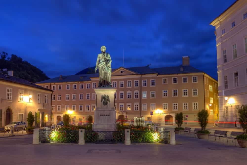 Mozart statue on Mozart Square, Mozartplatz, in Salzburg by night, Austria,