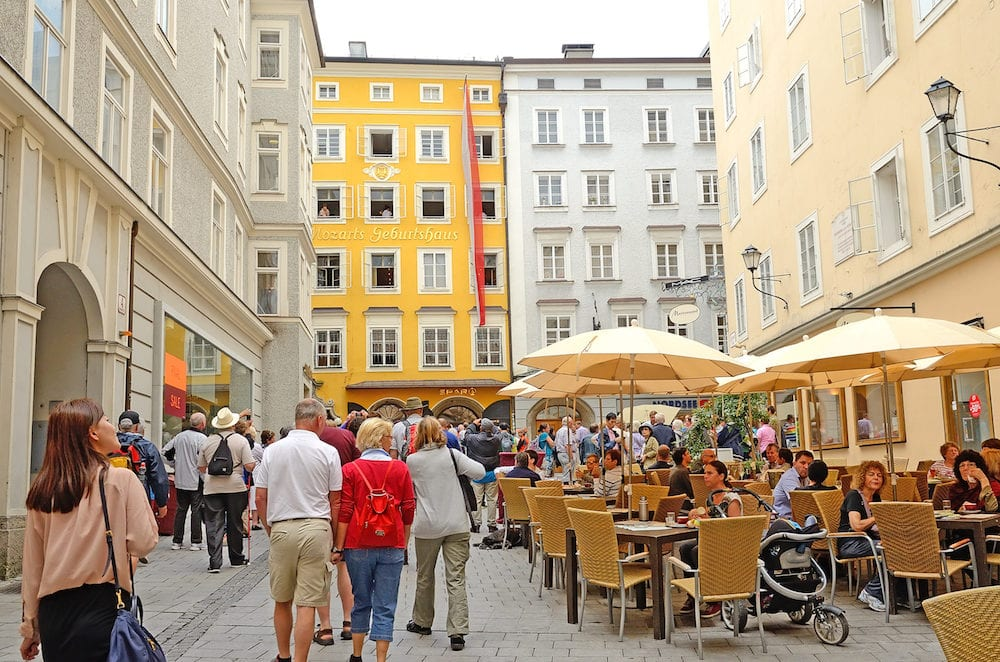 "SALZBURG AUSTRIA - Tourists go to the Mozart's Birthplace in Salzburg Austria. Mozart lived on the third floor of the ""Hagenauer House"" at Getreidegasse 9 from 1747 to 1773."
