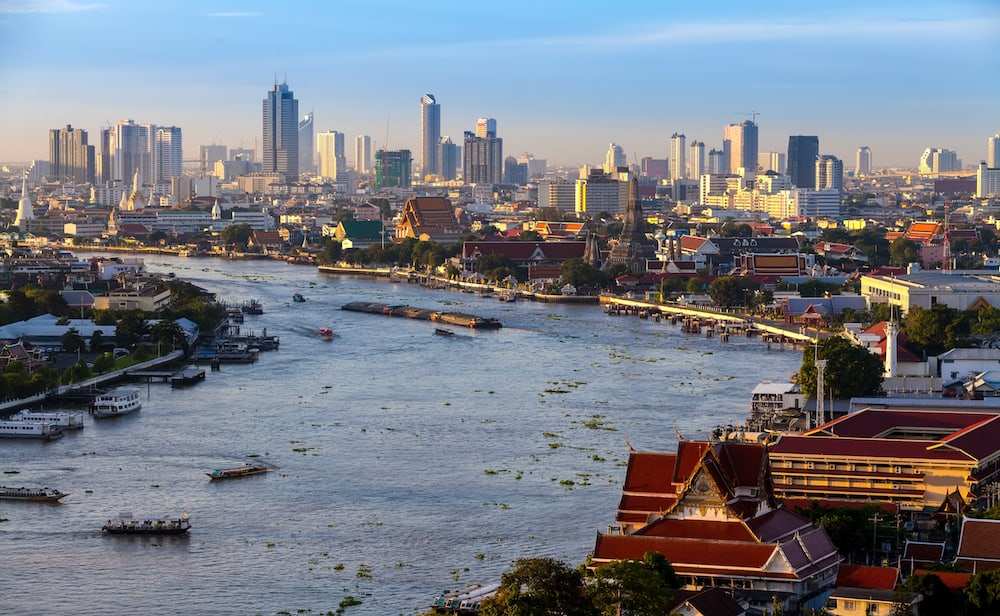 Bangkok City and chaopraya river in twilight time Hotel and resident area in the capital of Thailand
