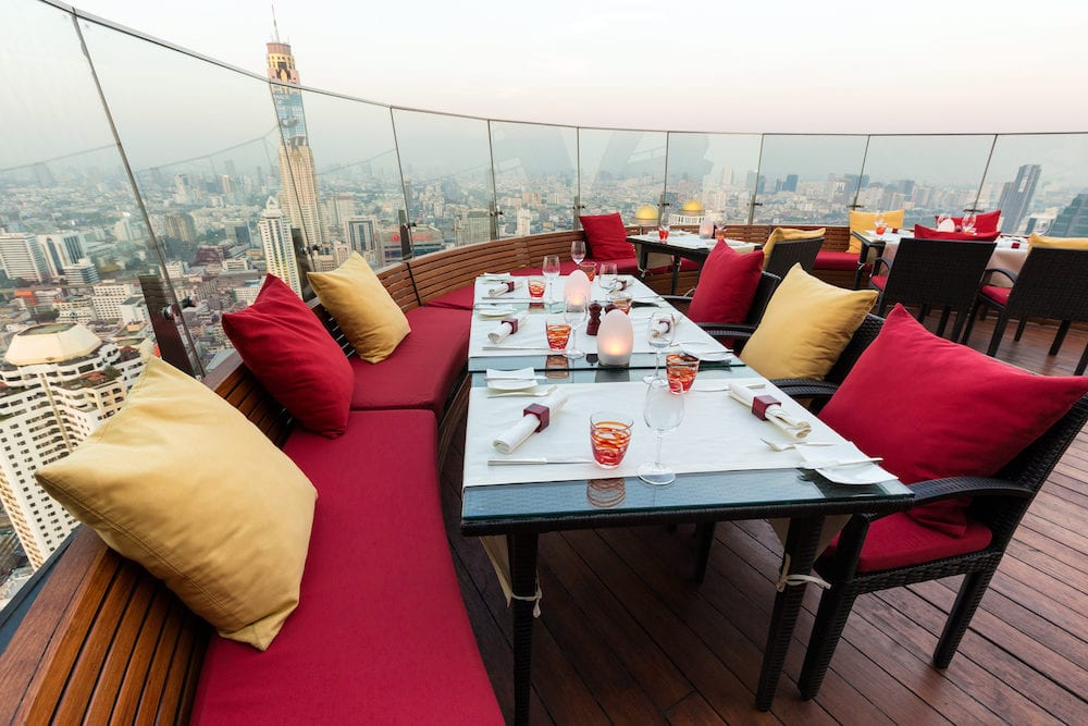 BANGKOK, THAILAND, Restaurant table with view on the Baiyoke tower and the cityscape at the Red Sky Rooftop of the Centara hotel in Bangkok, Thailand.