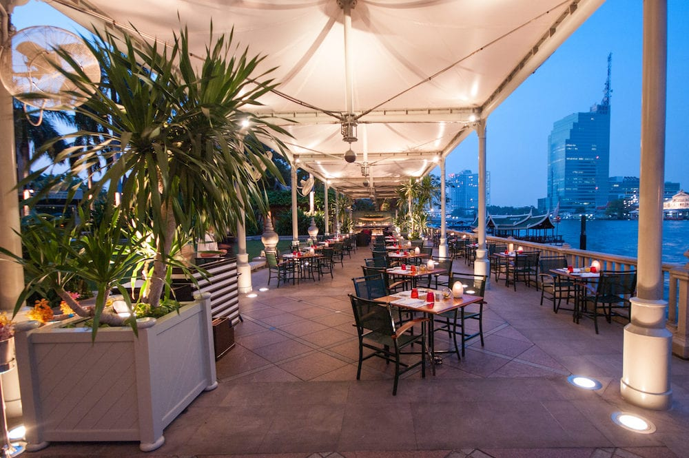 BANGKOKTHAILAND- nightview of the open restaurant of hotel peninsula along the chao praya river in Bangkok Thailand.