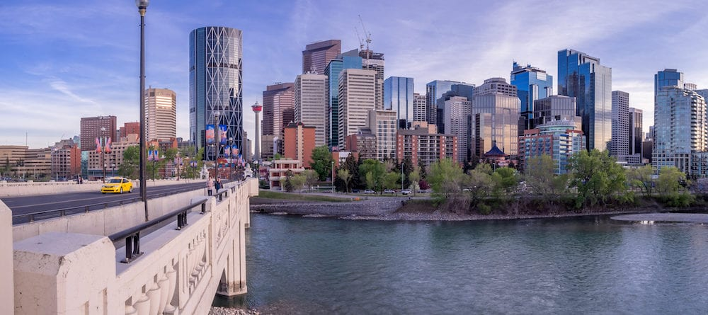 CALGARY, CANADA -Panorama of Calgary's skyline from the centre street bridge in Calgary, Alberta. The famous Bow River is in the foreground.