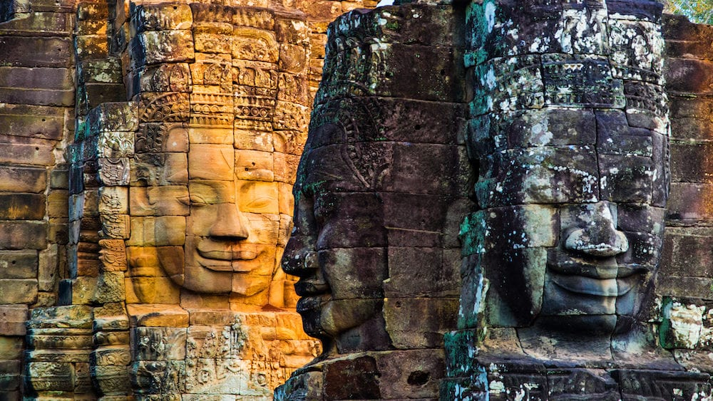 Stone murals and statue Bayon Temple Angkor Thom. Angkor Wat the largest religious monument in the world. Ancient Khmer architecture. Location: Siem Reap Cambodia.