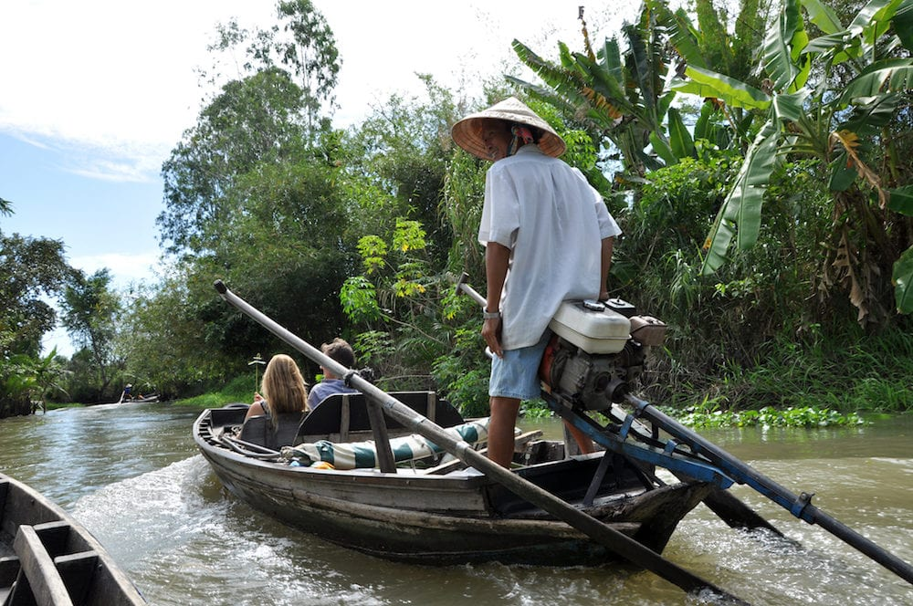 CAN THO VIETNAM - Tourists enjoying Mekong delta cruise with daily trip to local sights as the Cai Rang floating market and jungle trip