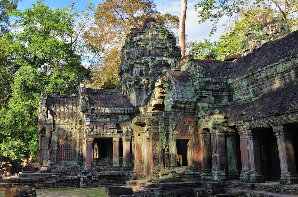 Ancient gallery of amazing Ta Prohm temple overgrown with trees. Mysterious ruins of Ta Prohm nestled among rainforest in Angkor Siem Reap Cambodia.