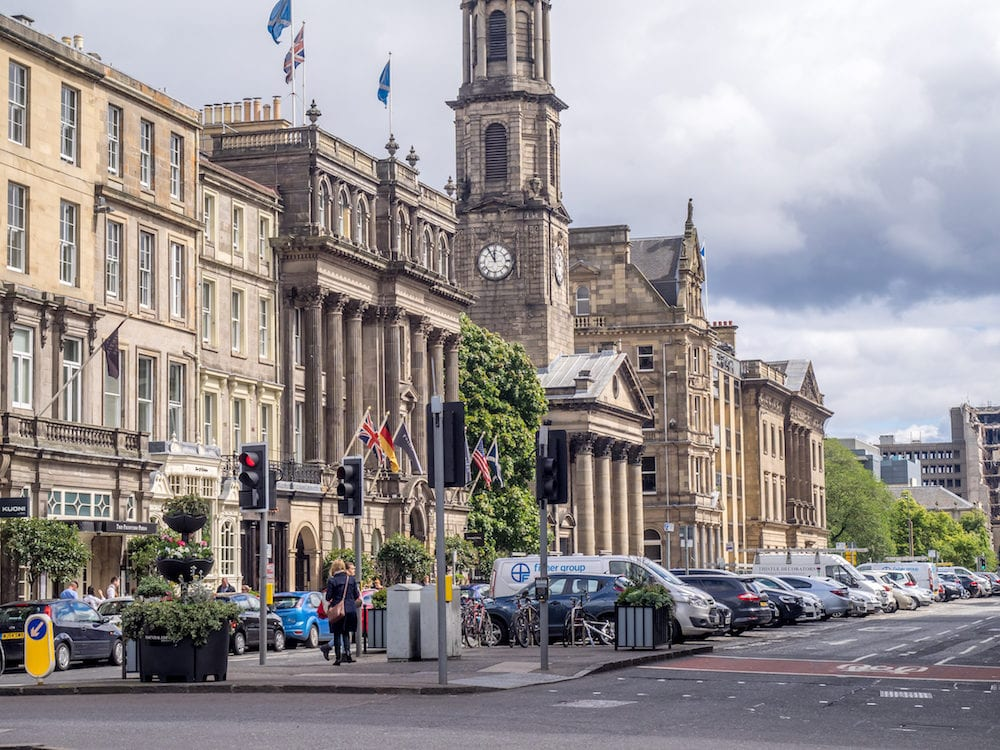 EDINBURGH, SCOTLAND - : Buildings and shops on George Street in the New Town in Edinburgh, Scotland. The famous New Town is a main shopping area of Edinburgh.