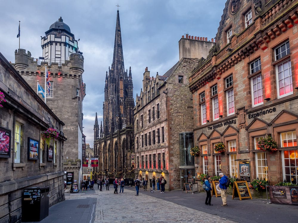 EDINBURGH, SCOTLAND - Looking down the Royal Mile in the Old Town in Edinburgh Scotland. The Royal Mile is the most popular attraction in Edinburgh and hosts many tourists.