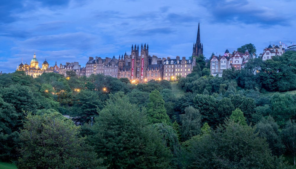 EDINBURGH, SCOTLAND - : Panoramic image of Edinburgh's Old Town skyline at night in Edinburgh Scotland. Edinburgh's Old Town is one to the most popular destinations.