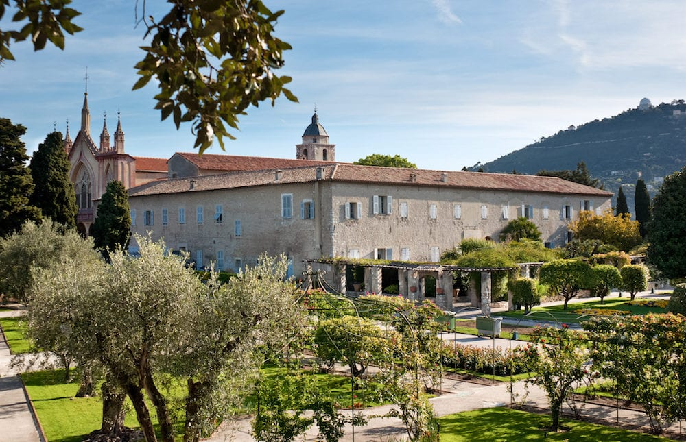 NICE, FRANCE - Monastery of Our Lady of Cimiez is surrounded by great garden with old olive trees and variety of rose bushes in Nice France.