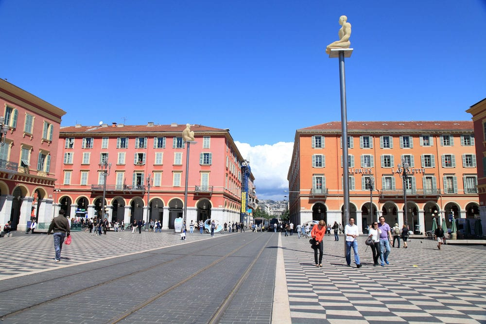 NICE, FRANCE - Tourists and local people on Place Massena - the main square of Nice, France.