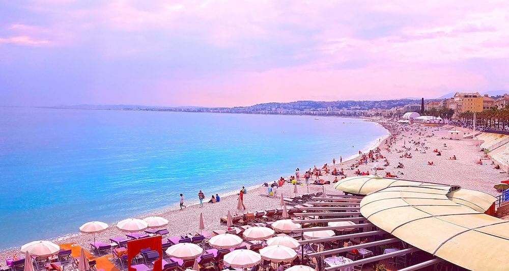 View of Nice city, Beach at sunset, Promenade des Anglais, Cote d'Azur, French riviera, Mediterranean sea, France